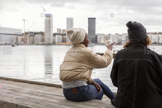 Female friends talking at sea