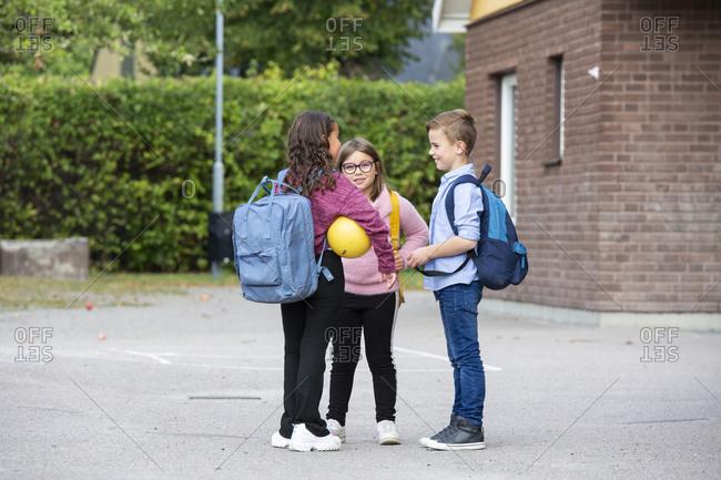 Friends talking on school yard