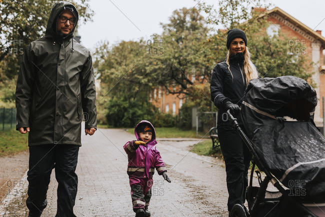 Parents walking with toddler girl