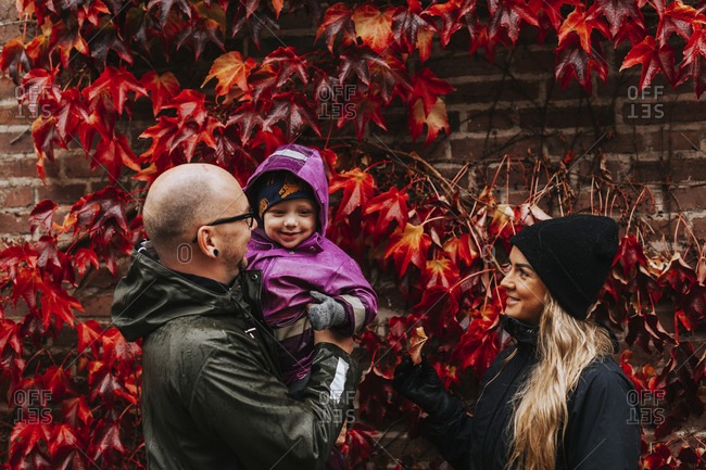 Parents standing with toddler daughter