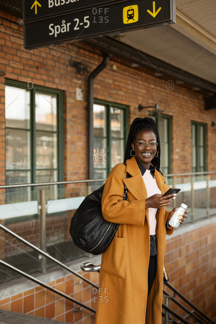 Smiling woman at train station