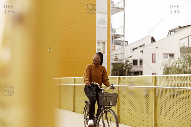 View of young woman cycling