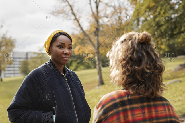 Young woman talking to friend