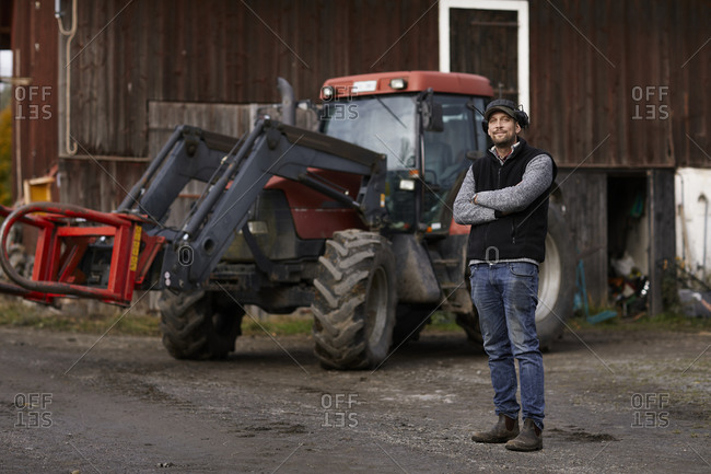 Farmer standing next to tractor