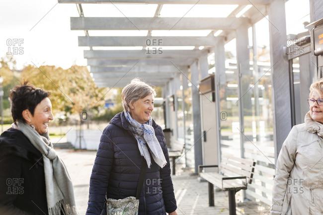 Senior women at train station