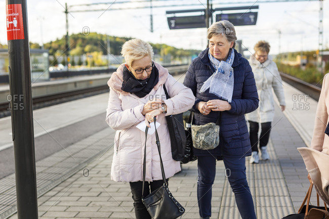 Senior women at train platform