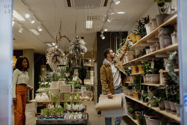 Young couple in flower shop