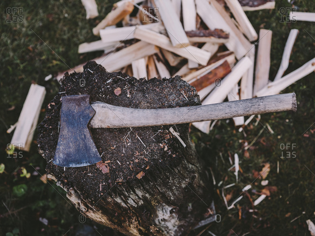 Axe on pile of firewood
