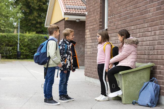 Children talking in front of school