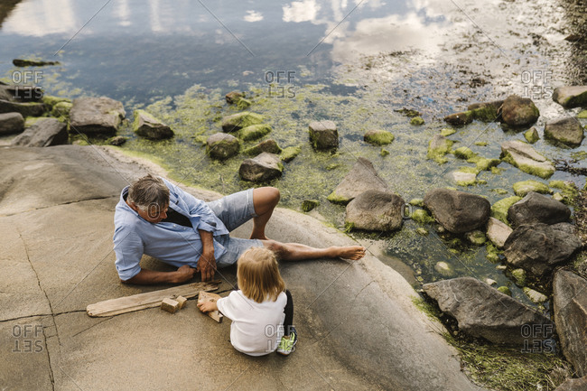 Father and daughter sitting at sea