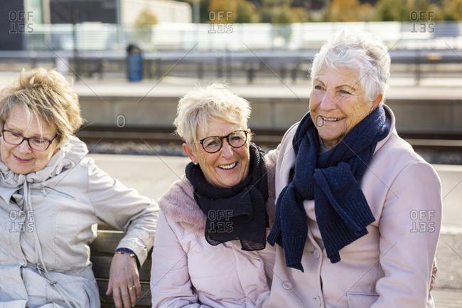 Senior women waiting at train platform