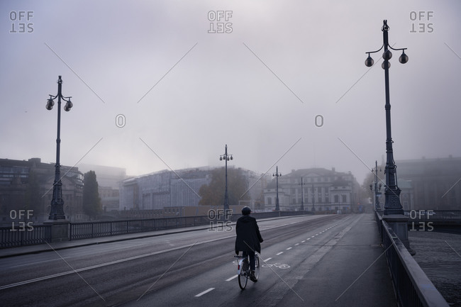 Silhouette of cyclist in foggy weather