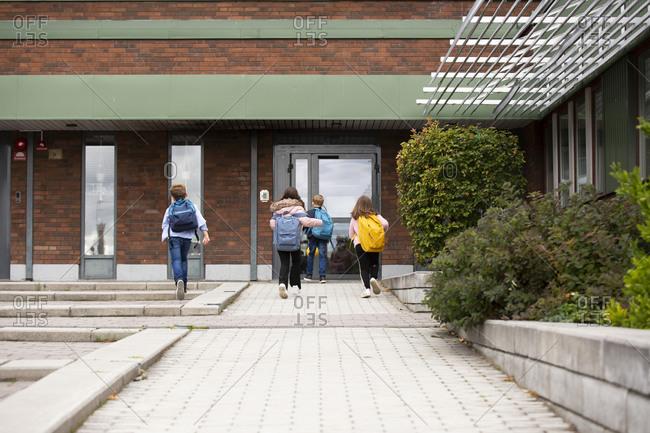 Children in front of school building