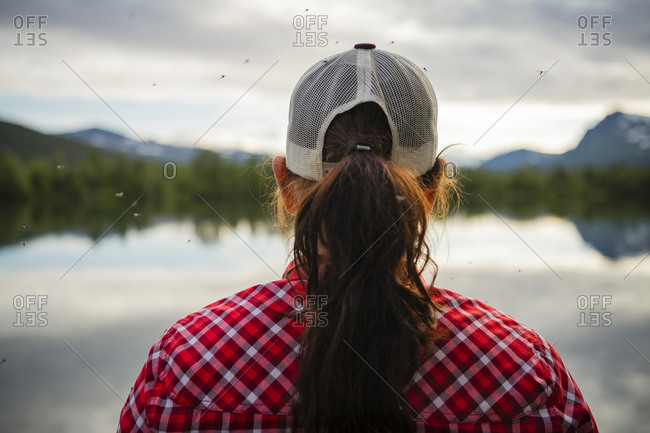 Rear view of woman at lake