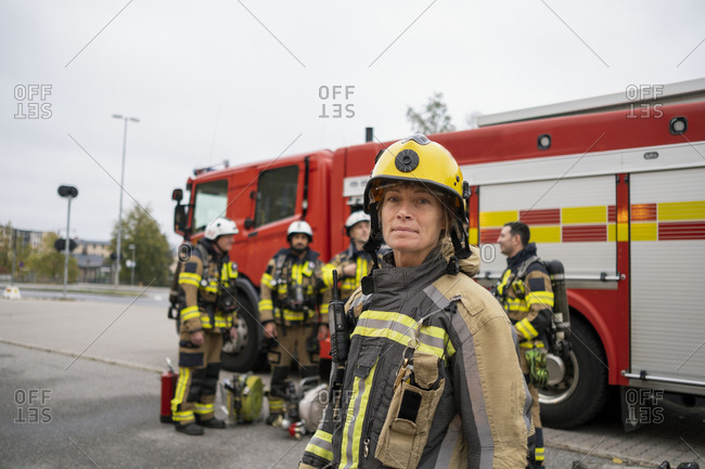 Female firefighter in front of fire engine
