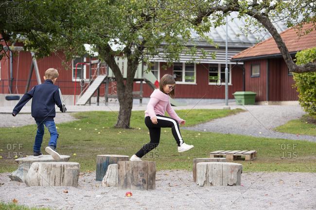 Boy and girl having fun on playground