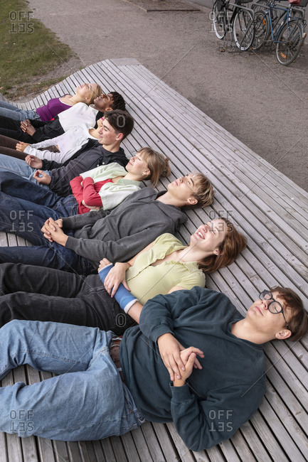 High angle view of teenage friends relaxing together
