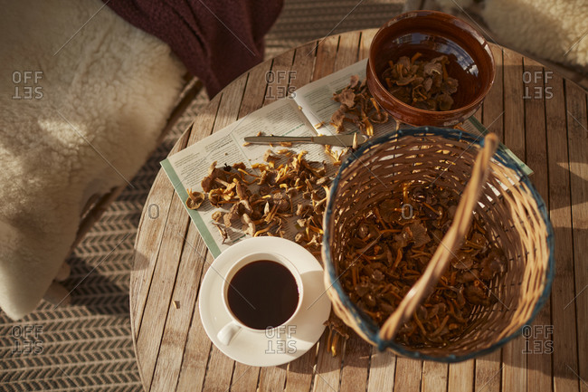 Coffee cup and freshly picked mushrooms on table