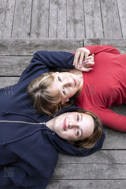 High angle view of teenage girls looking at camera