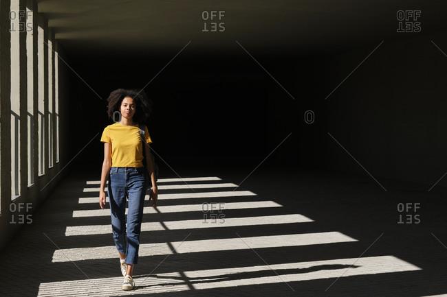 Female student walking at university corridor