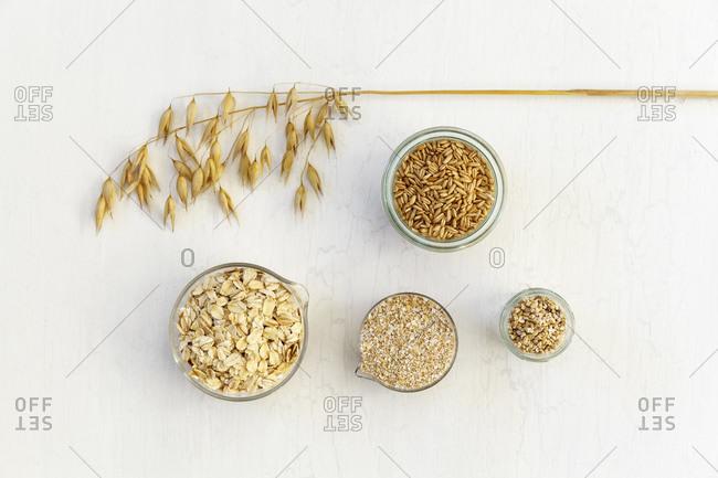 Studio shot of bowls and jars of fresh oats