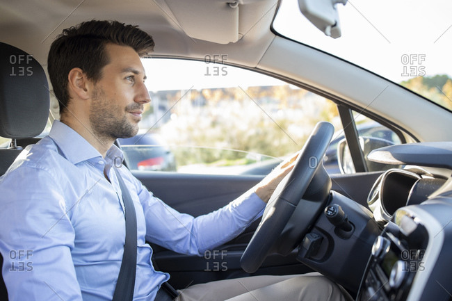 Male entrepreneur sitting in car on sunny day