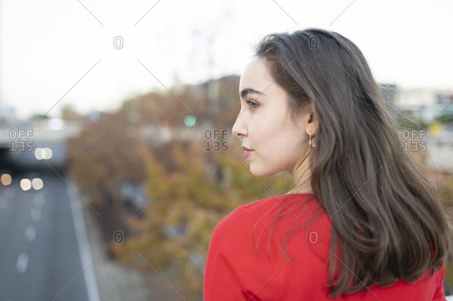 Young woman looking away as she walks