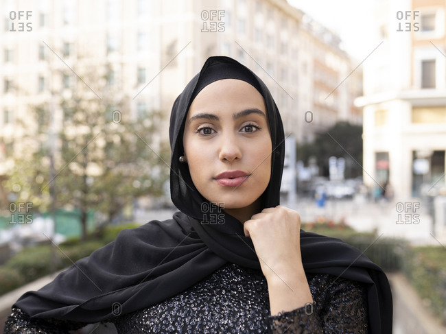Portrait of young beautiful woman wearing black hijab