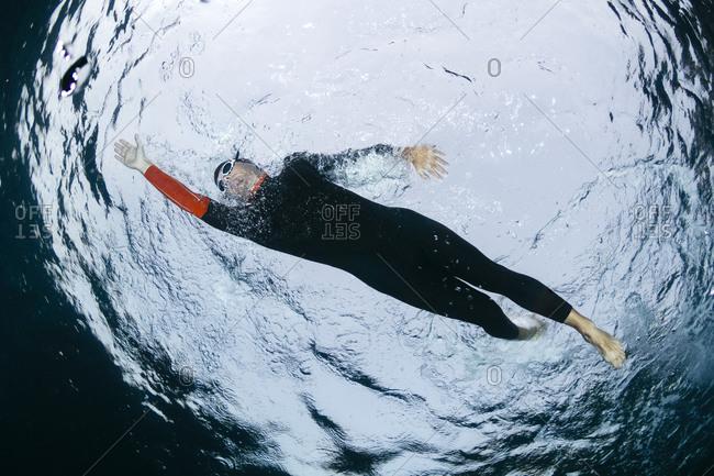 Underwater view of man diving in sea