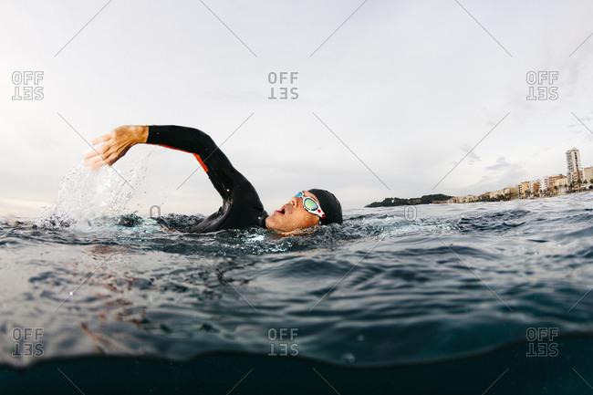 Man swimming alone in sea
