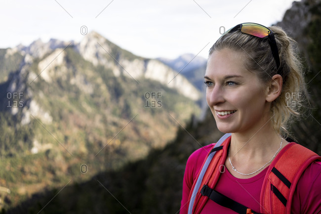 Smiling woman looking away while standing at Saulingspitze- Bavaria- Germany