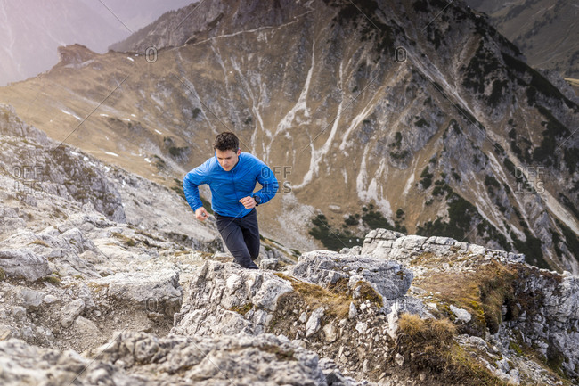 Athlete running on Ponten mountain at Tyrol- Austria
