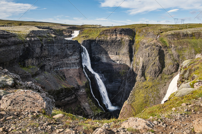 Beautiful landscape scenery of Haifoss waterfall flowing between mountain at Iceland