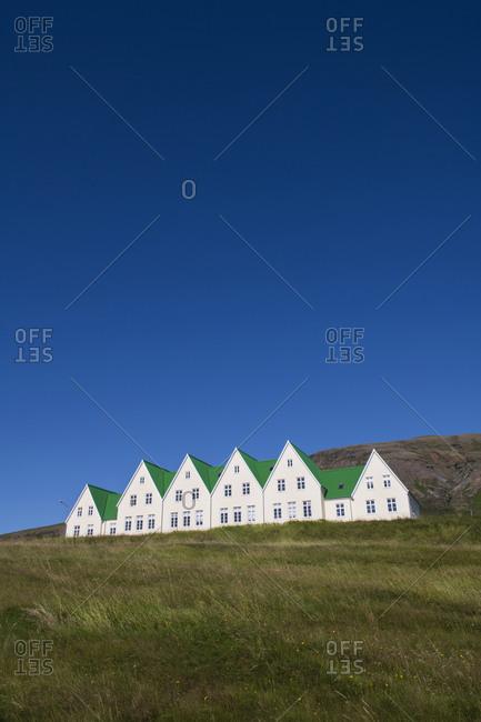 Heradsskolinn houses against clear sky at Laugarvatn- Iceland