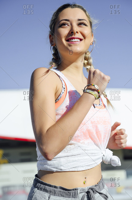 Female athlete smiling while running outdoors