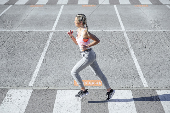Athlete practicing while running on road