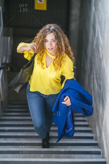 Stylish young female leaving underground