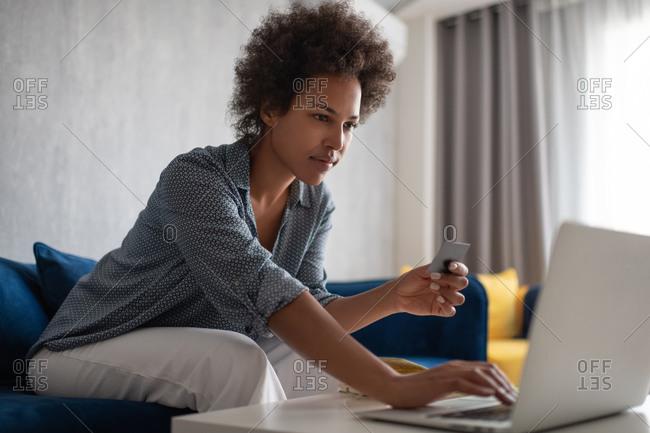 Ethnic female doing online shopping
