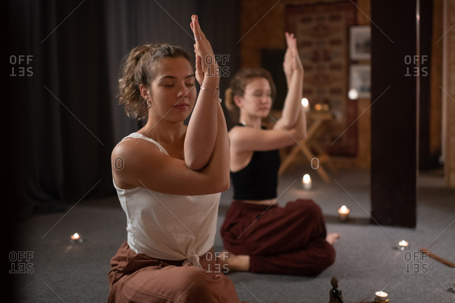 Women meditating with Eagle arms