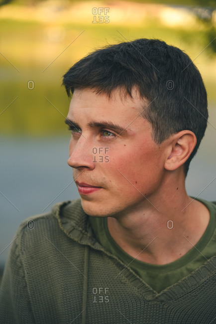Green-eyed country boy at sunset