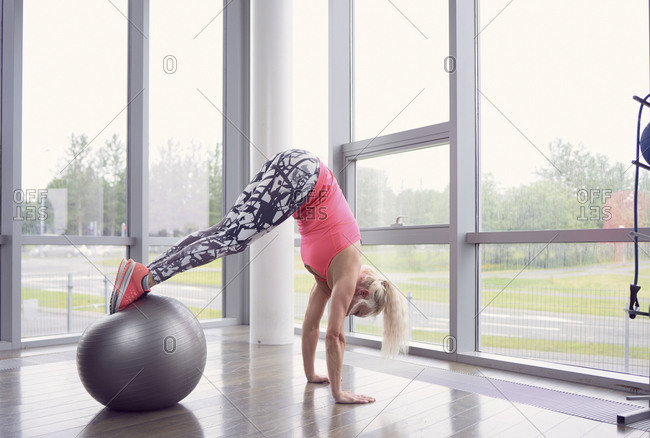 Slim woman exercising on ball