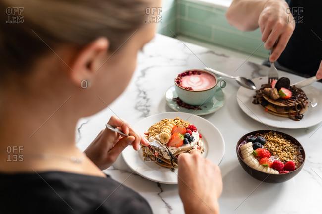 people enjoying breakfast, pancakes and sweets