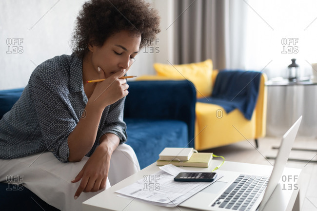 African American woman pondering over taxes