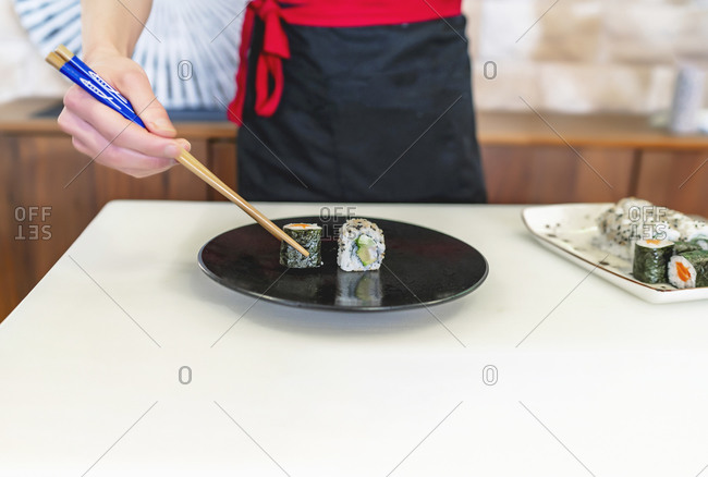 expert japanese chef preparing sushi plate