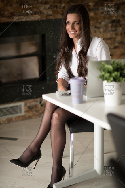 Young businesswoman in her modern office.