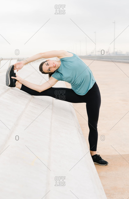 Girl practicing side stretch yoga posture