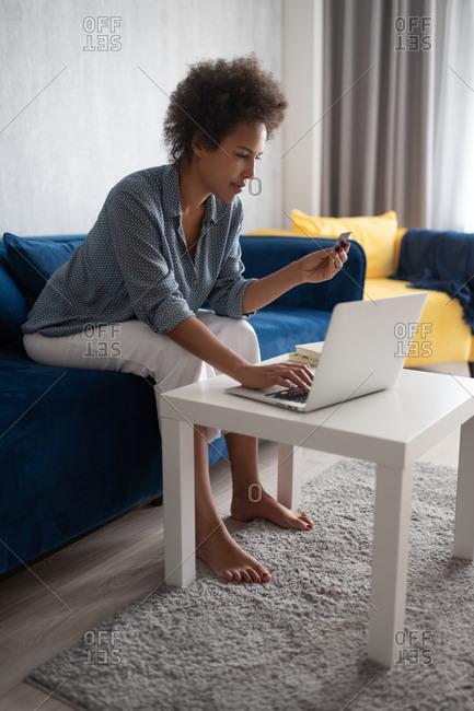 Black woman browsing online shop website