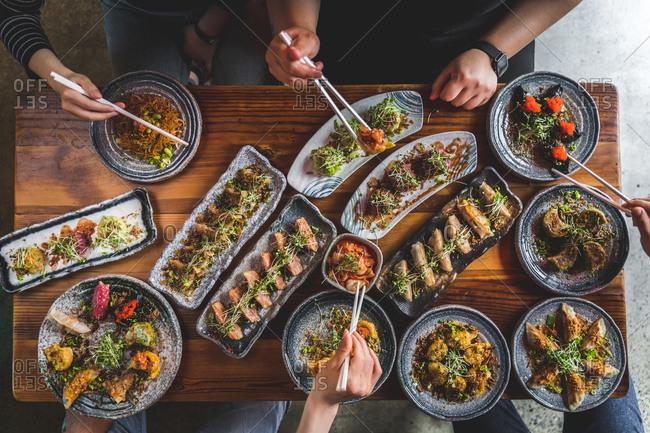 flatlay of people enjoying Asian food