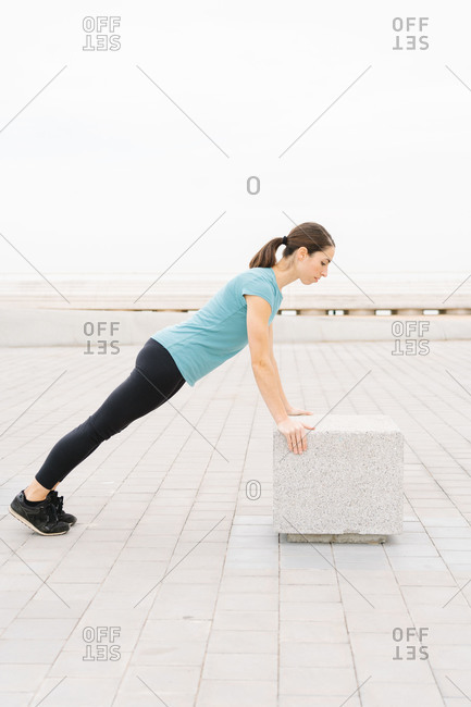girl practicing yoga on the street