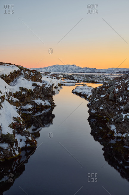Fjord and snowy cliffs at sunrise